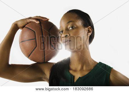 Mixed race woman holding basketball