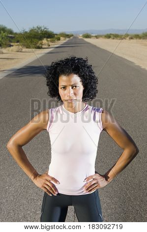 African woman standing on remote road