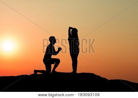 Silhouette Of Attractive Confident Half Naked Man Propose Marriage To Bikini Womansilhouette Of Attr