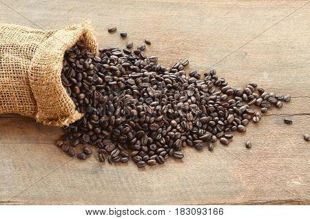 coffee bean in bag sack on wood background