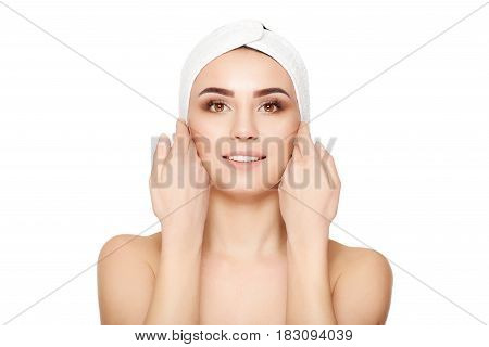 Beautiful young woman touches her face on white background, looks at the camera. Beautiful Woman Face Portrait Beauty Skin Care Concept