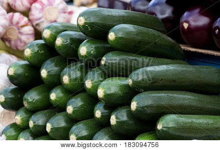 fresh green zucchini ready for sale at a local farmers' market