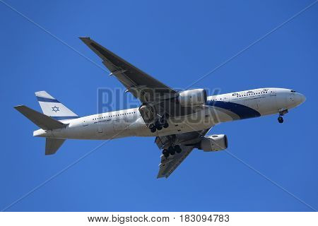 NEW YORK - APRIL 18, 2017:  El Al Boeing 777 descends for landing at JFK International Airport in New York