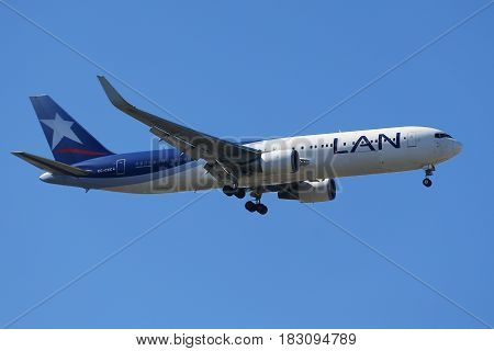 NEW YORK - APRIL 18, 2017: LAN airlines Boeing 787 Dreamliner descends for landing at JFK International Airport in New York