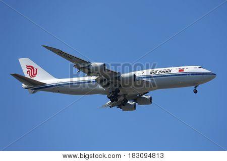 NEW YORK - APRIL 18, 2017:  Air China Boeing 747 in New York's sky before landing at JFK Airport