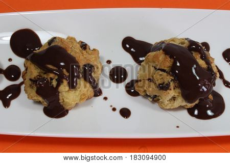 Isolated chocolate chip cookie on orenge background