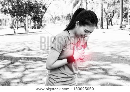 Attractive Confidence Asian Woman Runner Having A Heart Attack During A Run
