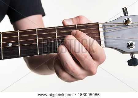 The Guitarist's Hand Clamps The Chord A On The Guitar, On A White Background. Horizontal Frame