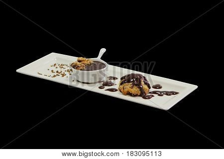Isolated chocolate chip cookie on black background