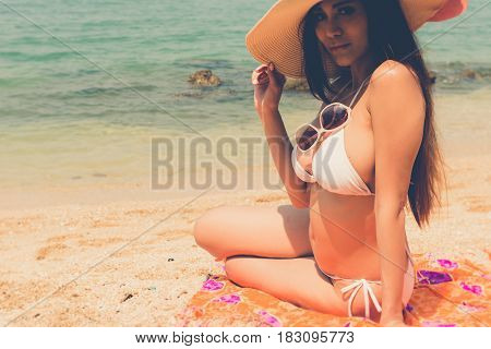 Beautiful Attractive Large Breast Asian Bikini Woman Sitting On Beach Looking Sexy