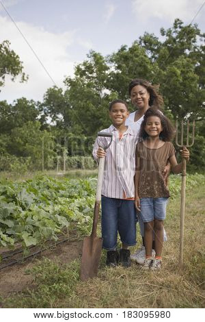 African mother and children in garden