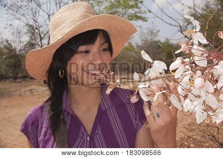 Chinese woman looking at flowering tree