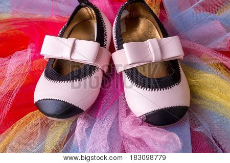 Baby Girl Pink Shoes On Colored Tulle Background. Top View.