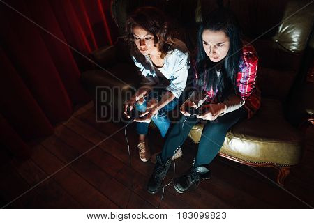 Two young girls addicted to video game. Problems with health, excessive play, psychological disorder. Addiction and unhealthy lifestyle concept