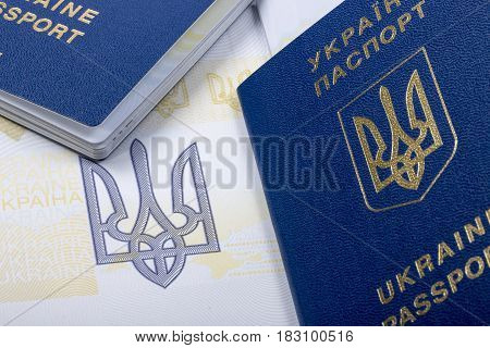 Several Ukrainian biometric passports with the arms close-up