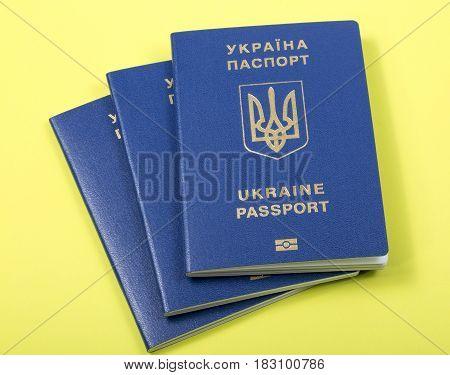Ukrainian biometric passports on a yellow background