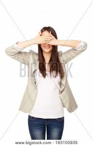 Young woman close her's eyes with hands isolated on white