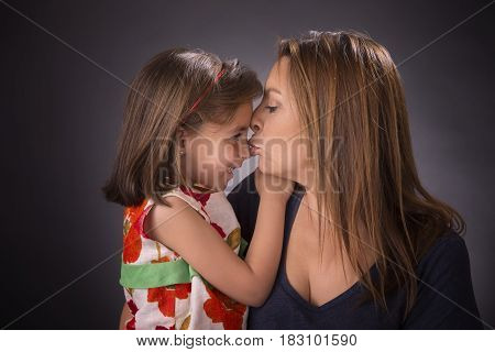 Young Woman Kissing Girl