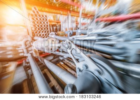 Industrial Warehouse. Various mechanisms and gray metal pipe. Toning the image. Motion blur effect. Bright sunlight.