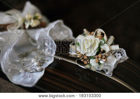 Accessories for bride: earrings with buttonhole. Wedding
