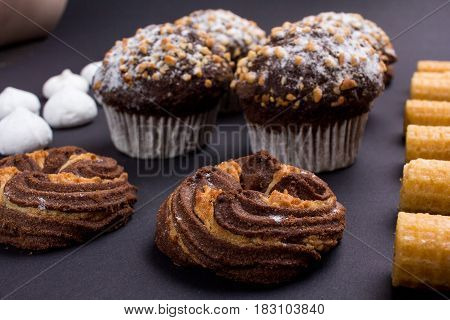 still life - set of sweets on a black background