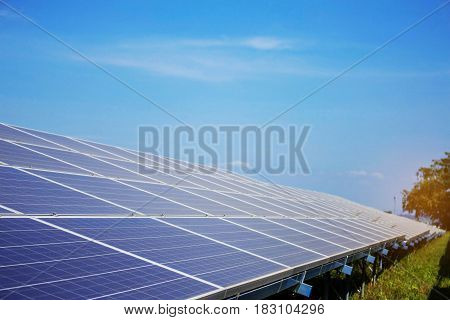 Solar panel on grassland with blue sky.