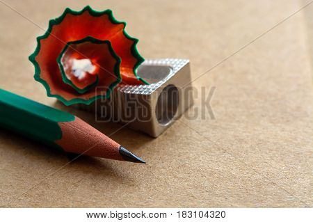sharpener for pencils on craft paper with traces of pencil
