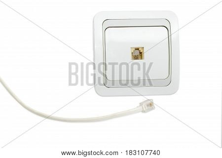 White and gray domestic telephone wall socket and part of the telephone cable with corresponding plug on a light background