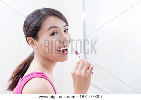 beauty woman brush tooth and smile happily in the bathroom