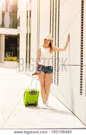 Attractive Woman With Suitcase Relaxing After Arrival