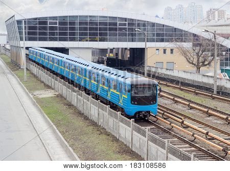 Train of the metro system moving on the overground part of the subway line