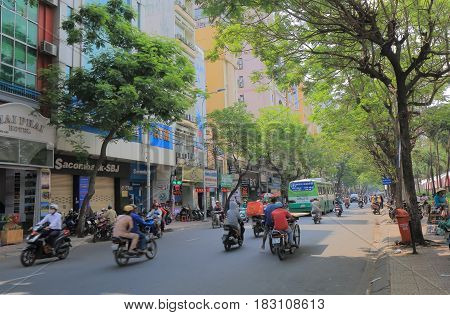 HO CHI MINH CITY VIETNAM - NOVEMBER 26, 2016: Unidentified people drive on Pham Ngu Lao street. Pham Ngu Lao street is a famous backpacker street.