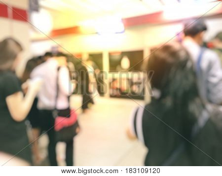 Blur Image Of People Waiting For Their Respective Public Transport.