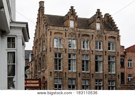 Bruges Belgium - July 29 2016: Typical brick building in the city of Bruges. The historic city centre is a World Heritage Site of UNESCO. It is known for his picturesque cobbled lanes and dreamy canals
