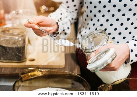 Woman Cafe Worker Adding Sugar To Bowl