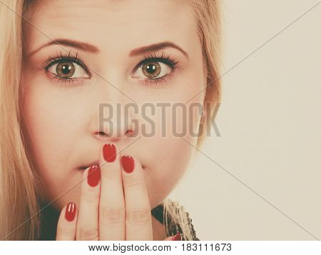 Shocked Woman Covering Mouth With Hands