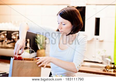 Woman Small Local Shop Owner Packing Shopping