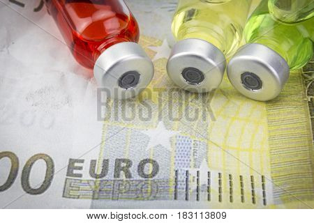 vials with different substances over euros concept of copayment