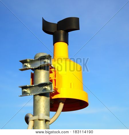 Close up of anemometer (wind-gauge) on top of pole