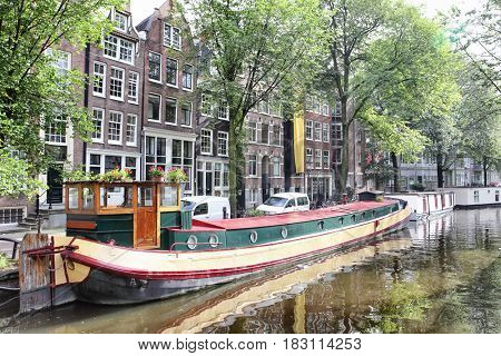 View of Amsterdam canal with boats, Netherlands