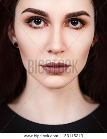 Close-up portrait of young beautiful woman's face with eloquent eyes.