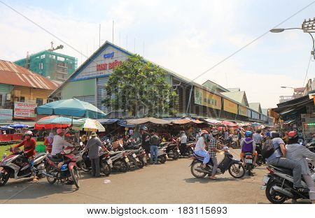 HO CHI MINH CITY VIETNAM - NOVEMBER 27, 2016: Unidentified people visit Kim Bien market in Chinatown.