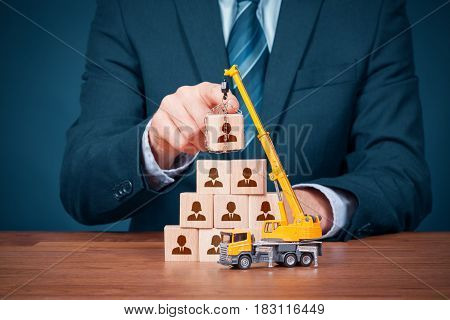 Human resources build team and corporate hierarchy concept - recruiter complete team by one leader person (CEO manager) represented by icon.
