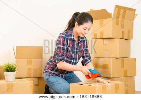 Woman Unpacking Carton Boxes