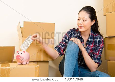 Woman Looking Piggy Bank For Saving