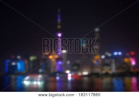 Abstract background of Oriental Pearl TV Tower with blur lights background in Shanghai China