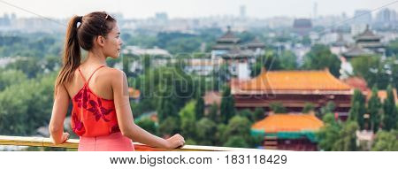 China summer travel banner woman in Asia. Chinese tourist relaxing looking at view of famous chinese landmark, the forbidden City in Beijing.