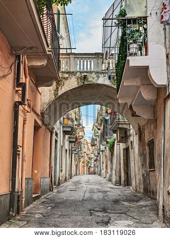 Ortona, Abruzzo, Italy: picturesque ancient narrow alley with archway and balconies in the old town