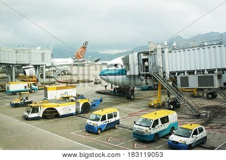 HONGKONG China. April 21 2017: Airplane is being loaded with cargo in preparation for departure at Hong Kong International Airport.