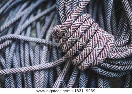 climbing equipment on the ground. climbing Rope rolled up